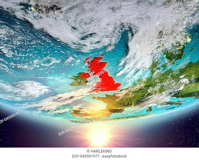 United Kingdom during sunrise highlighted in red on planet Earth with clouds. 3D illustration. Elements of this image furnished by NASA