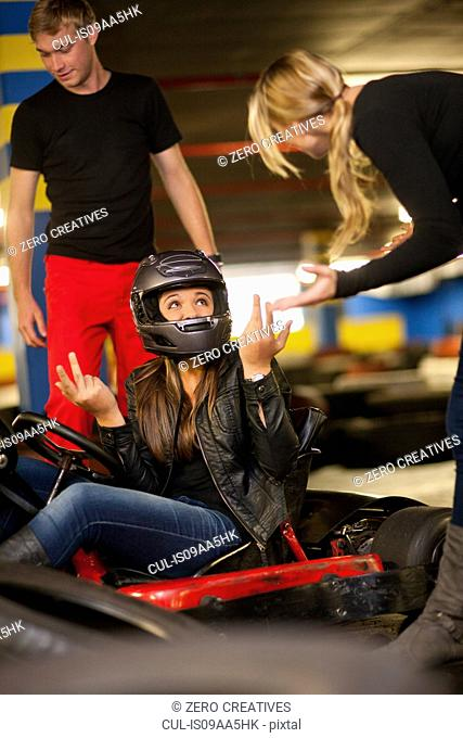 Teenage girl sitting in go cart after accident