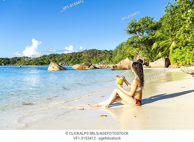 A beautiful woman relaxing on the beach. Anse Lazio, Praslin, Seychelles, Africa