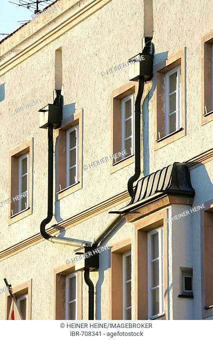 Windows and eaves trough on a building facade in Muehldorf am Inn, Upper Bavaria, Bavaria, Germany, Europe