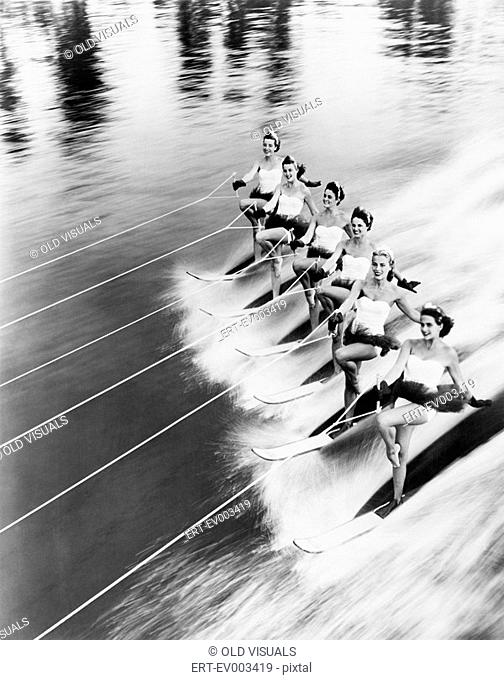 Row of women water skiing All persons depicted are not longer living and no estate exists Supplier warranties that there will be no model release issues