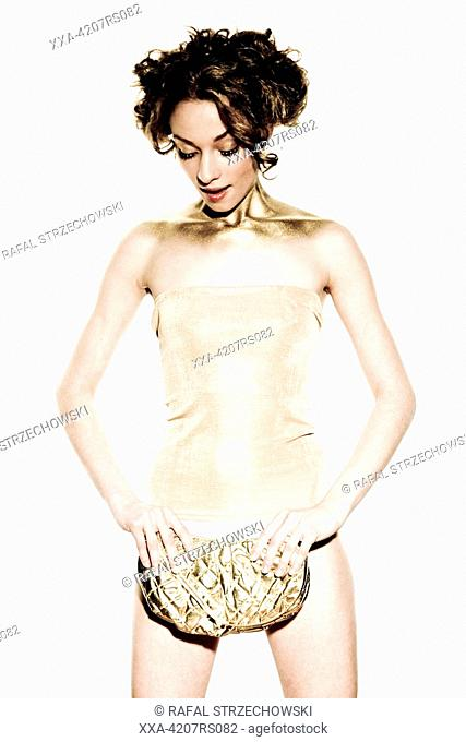 young woman with gold handbag