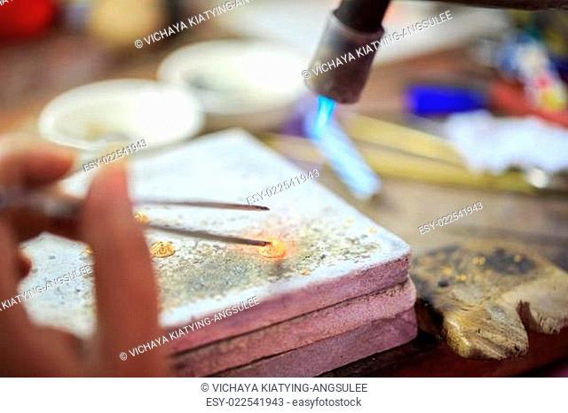 Goldsmith making gold