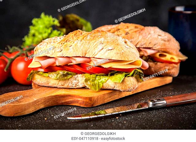 Ciabatta sandwich with vegetables, cheese and ham