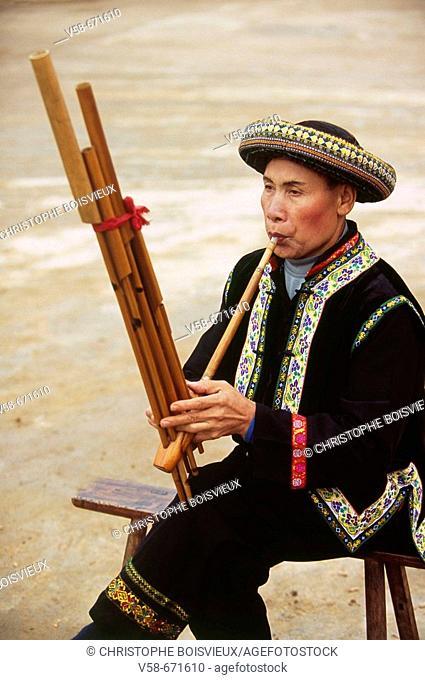 Lusheng player, miao lusheng festival, gulong, guizhou, China
