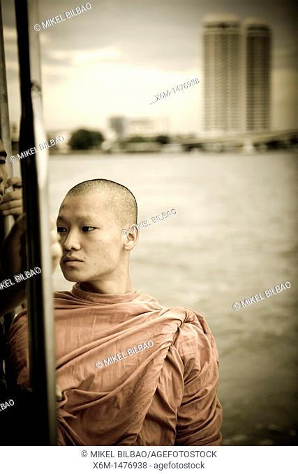 Buddhist monk and Chao Praya river  Bangkok, Thailand, Asia