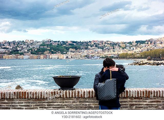 Lovers on promenade, Naples, Campania, Italy