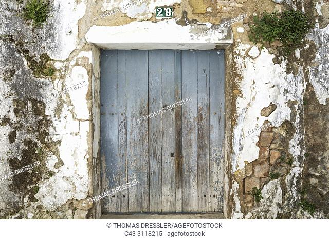 Façade of an abandoned building in the hilltop White Town of Arcos de la Frontera. Cadiz province, Andalusia, Spain