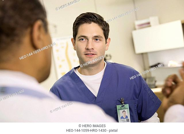 Male nurse discussing with doctor