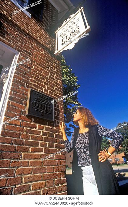 Woman Reading Plaque on Star Spangled Banner Flag House, Baltimore, Maryland