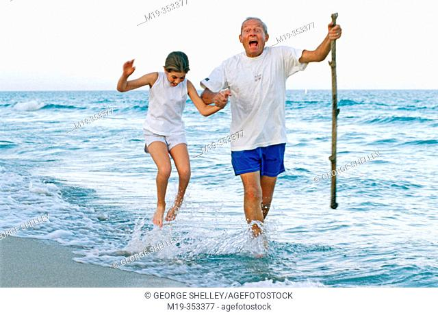 Grandfather and Grandaughter at the beach