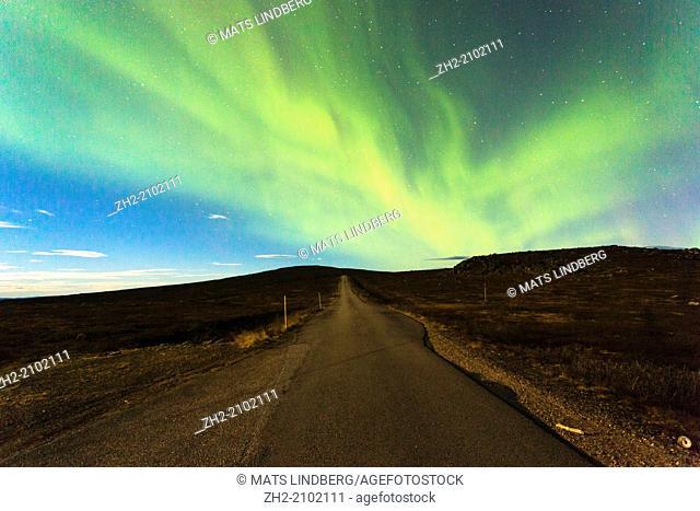 Norhern light, Aurora borealis, and aroad going straight in Gällivare, Swedish lapland