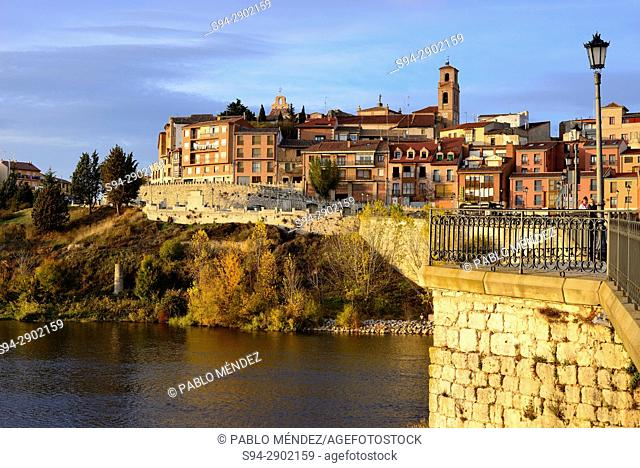 Bridge over Douro river and facades of Tordesillas town, Valladolid, Spain