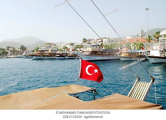 Turkish flag in Marmaris harbor Turkey