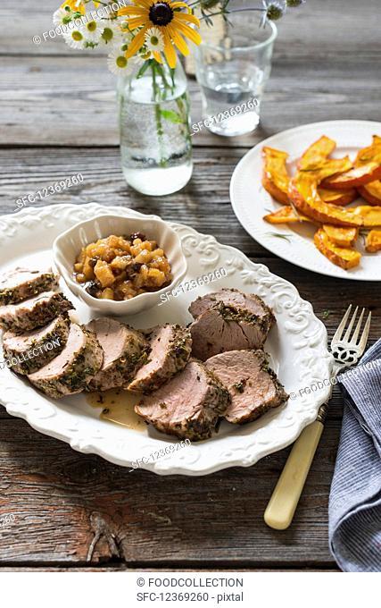 Pork loin with herbs, pear chutney and roasted pumpkin