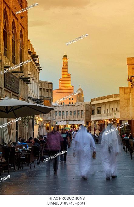 Blurred view of people walking on Doha street, Doha, Qatar