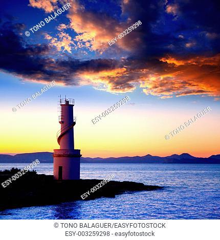 Ibiza island sunset of Es Vedra and La Savina lighthouse in Formentera