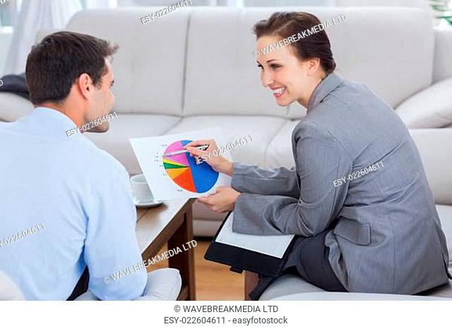 Colleagues analyzing diagram together