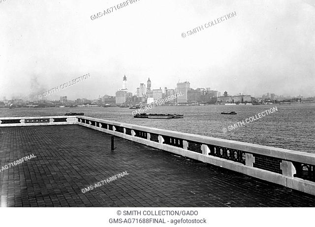 Black and white photograph with view of the New York City skyline from the observation roof atop the Immigration Station on Ellis Island, by Edwin Levick
