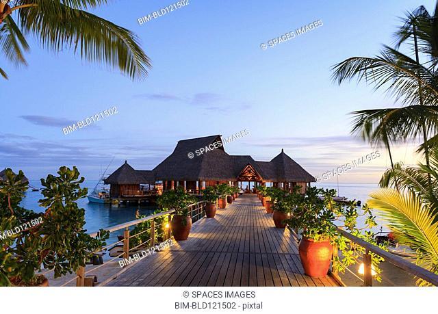 Deck and restaurant over tropical ocean, Bora Bora, French Polynesia