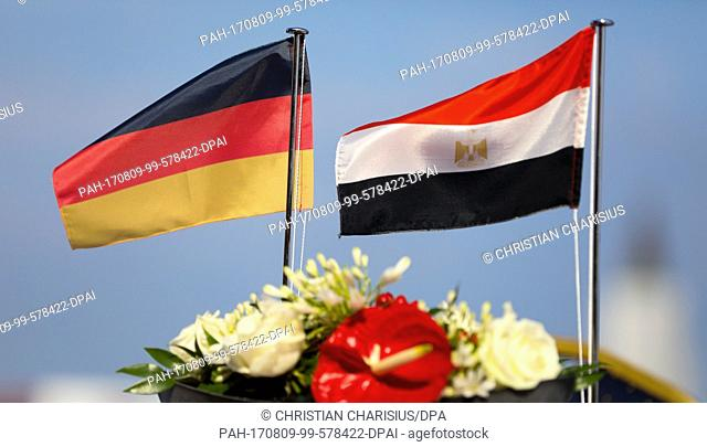 A German and an Egyptian flag om a wharf in front of the S42 submarine manufactured by ThyssenKrupp Marine Systems for the Egyptian navy during a ceremonial...