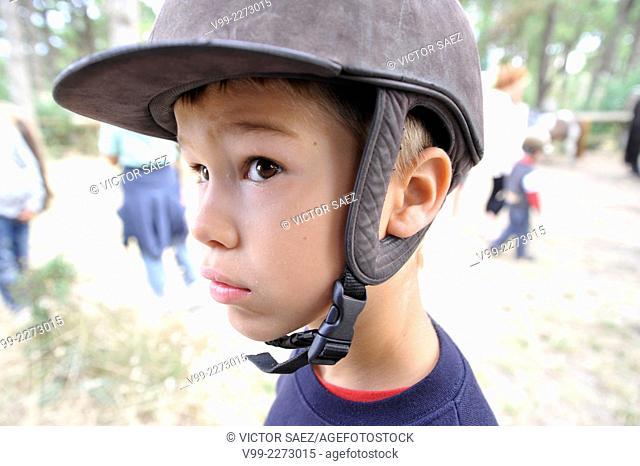 Boy with riding helmet