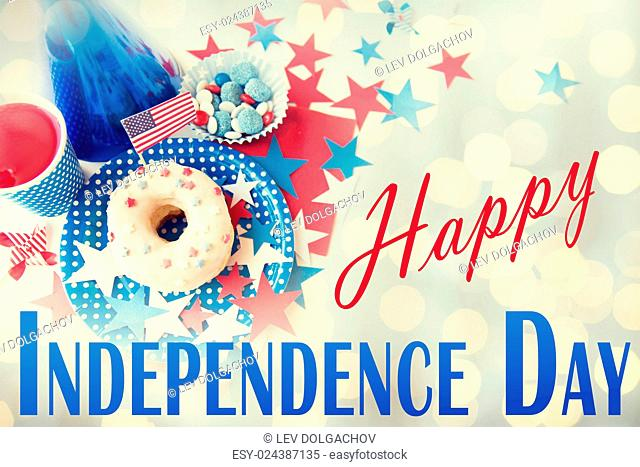 happy american independence day, celebration, patriotism and holidays concept - close up of donut with juice drink and candies in disposable tableware at 4th...