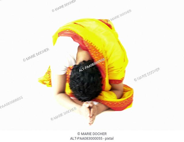 Hindu man bending over, praying