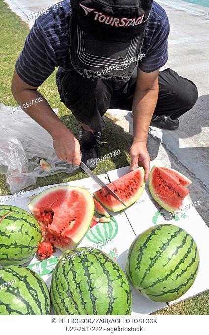 Itoman, Okinawa, Japan: watermelons during a wedding party at Bibi Beach