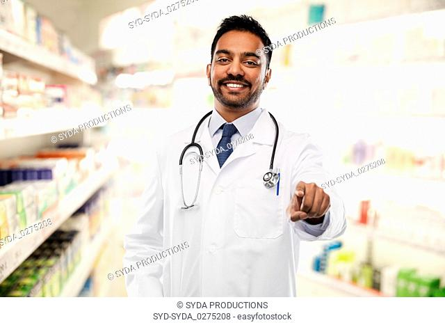 smiling indian male doctor pointing finger to you
