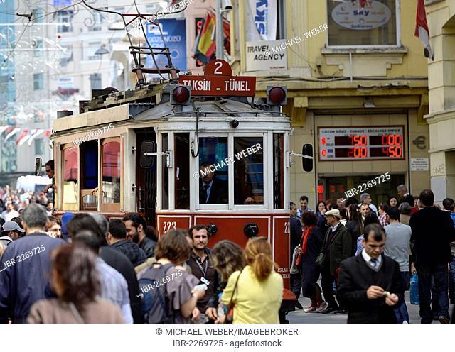 Historic tram driving through the crowds, Istiklal Caddesi shopping street, Independence Street, Beyoglu, Istanbul, Turkey, Europe, PublicGround
