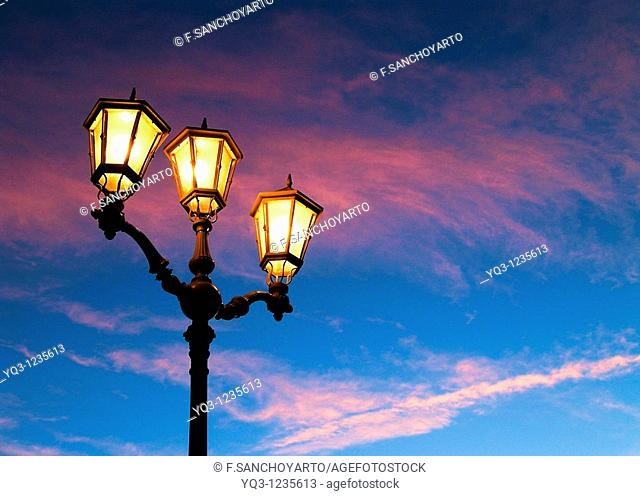 Street lamps in the early morning. Port of Castro Urdiales , Cantabria, Spain