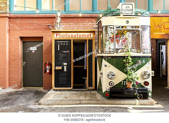 Berlin, Germany. Local markethall interior and interior decoration. An old and vintage tram trolley marks the entrance of the restroom area and toilets