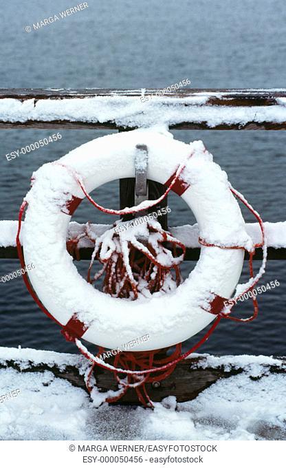 Life belt with snow at famous sea bridge in winter. Sellin, Rügen Island, Baltic Sea, Mecklenburg-Western Pomerania. Germany