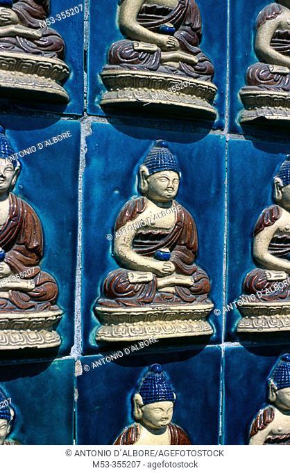 Glazed tiles with Buddha, White Dagoba Temple, Beihai Park. Beijing. China