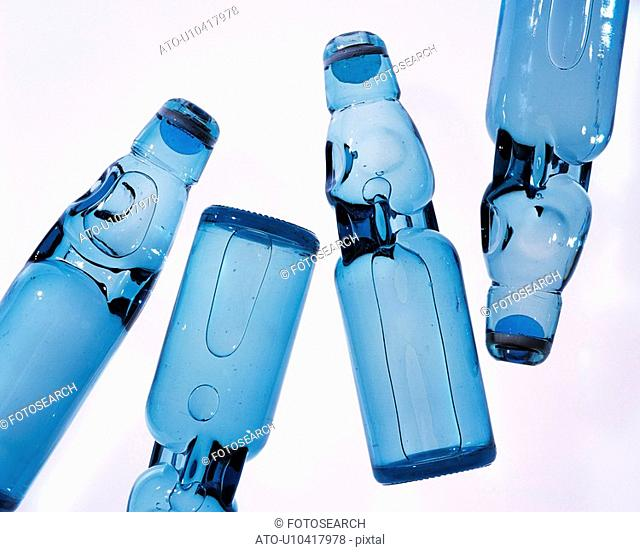 Soda bottles, high angle view, white background, cut out