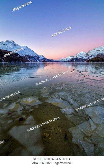 Sheets of ice on the surface of Lake Sils in a cold winter morning at dawn Upper Engadine Canton of Graubunden Switzerland Europe