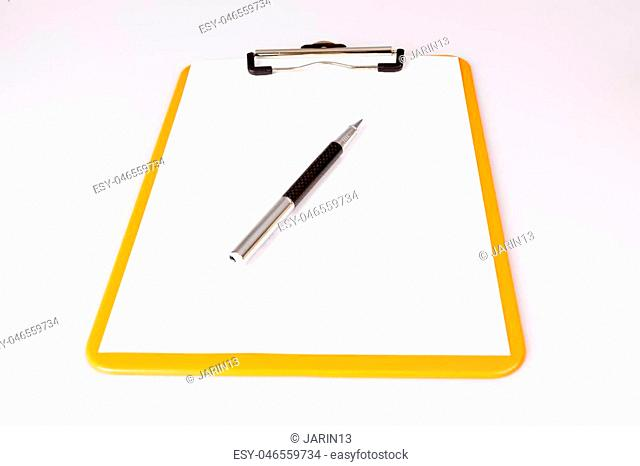 pen or pencil on empty paper in brown clipboard on white - business concept