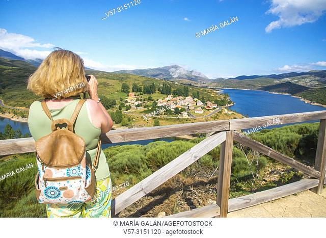 Mature woman taking photos at Camporredondo viewpoint. Alba de los Cardaños, Palencia province, Castilla Leon, Spain