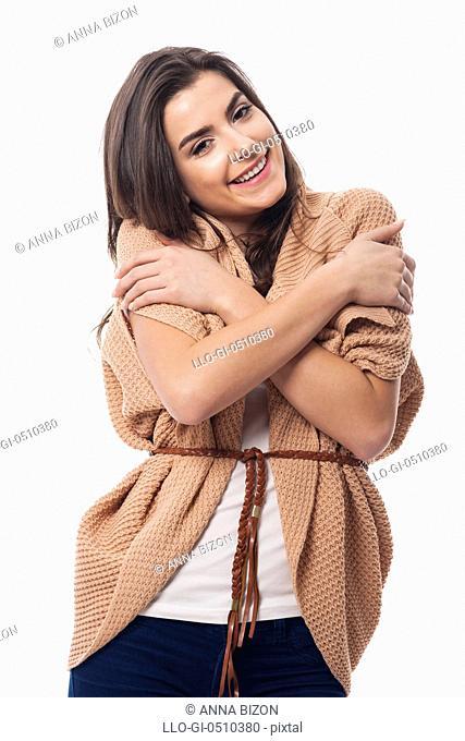Hugging woman in warm clothing. Debica, Poland