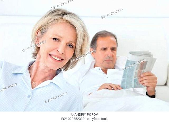 Happy Woman Sitting In Front Of Man