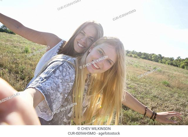 Two young women smiling towards camera