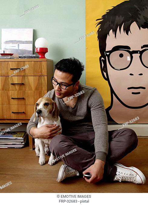 Man caressing dog at home