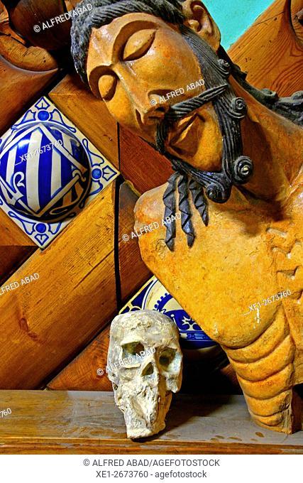 Religious image and skull, rehabilitation workshop, Barcelona, Catalonia, Spain