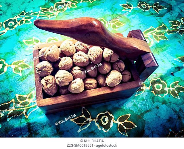 A goose neck nutcracker and box full of walnuts, Ontario, Canada