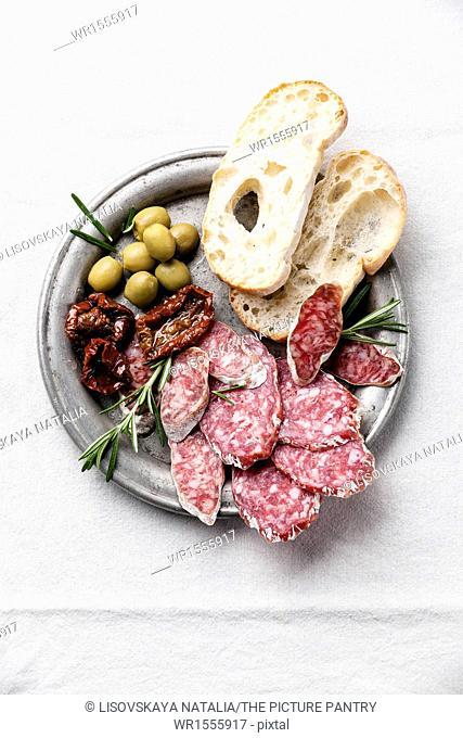 Italian salami with olives and ciabatta