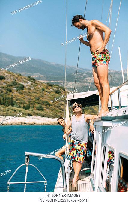 Men standing on boat