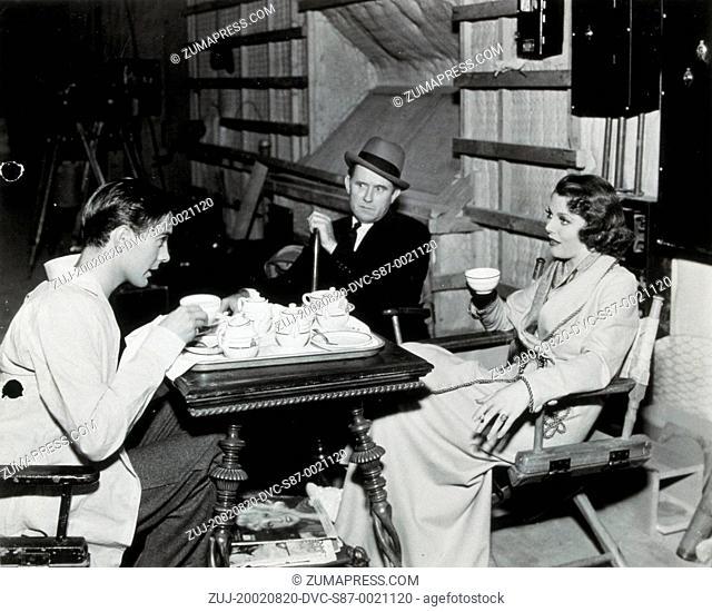1937, Film Title: LOVE IS NEWS, Director: TAY GARNETT, Studio: FOX, Pictured: BEHIND THE SCENES, DRINKING, TAY GARNETT, TYRONE POWER, TEA