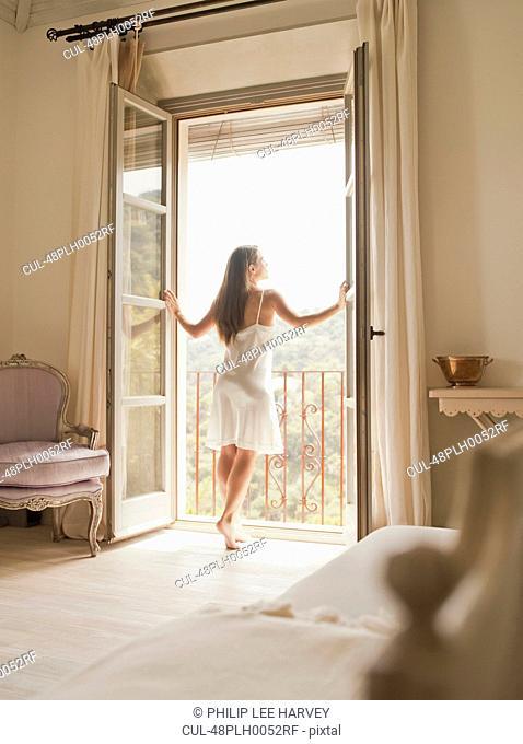 Woman walking on to balcony