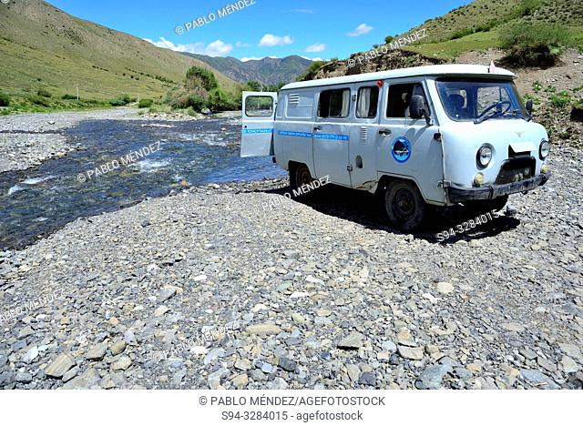 Off-road van. Driving to Kaindy lake, Kungey Alatau, Kazakhstan